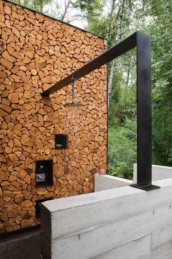 Mountain style outdoor patio shower photo in Austin with no cover