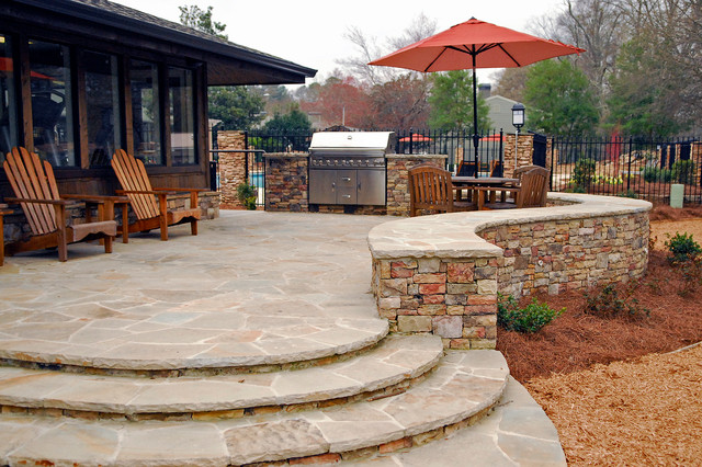 Stone design ideas traditional patio atlanta by for Backyard stone patio design ideas