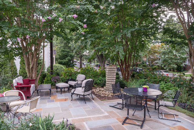 Patio fountain - mid-sized contemporary front yard stone patio fountain idea in DC Metro