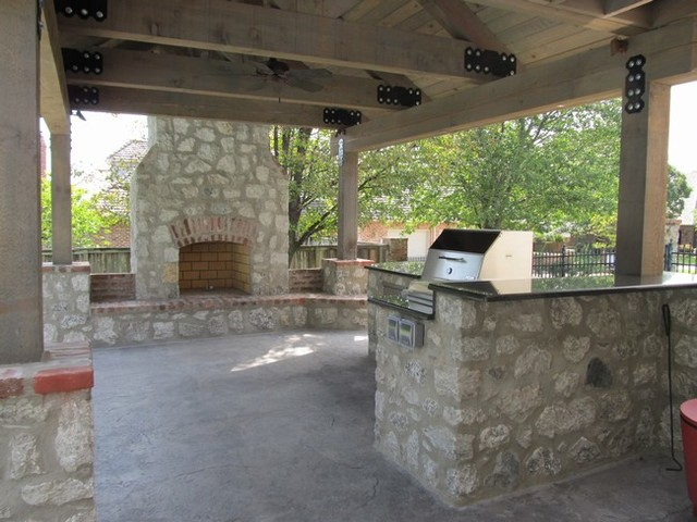 Stone Outdoor Kitchen Addition with Fireplace and Hasty Bake Charcoal