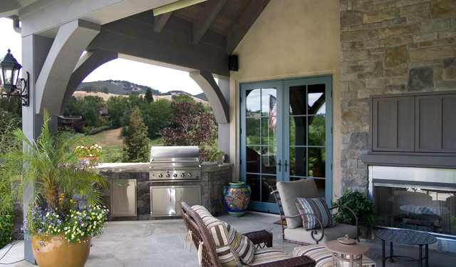 Stone Outdoor Kitchen and Fireplace midcentury-patio