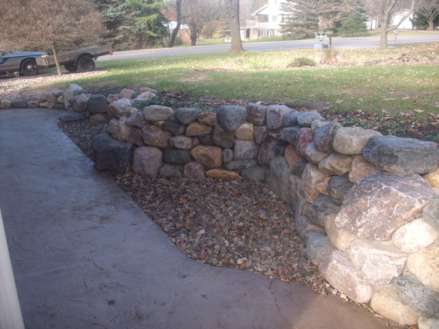Stone retaining wall, stamped patio, fireplace traditional-patio
