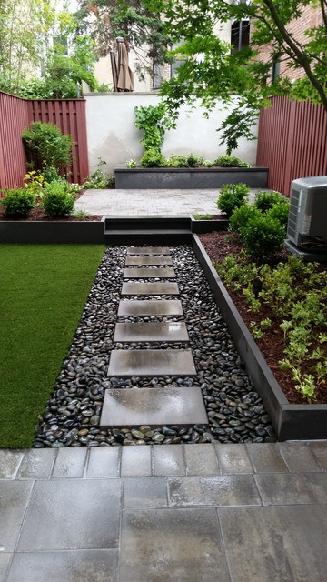 Small trendy backyard stone patio container garden photo in New York with no cover