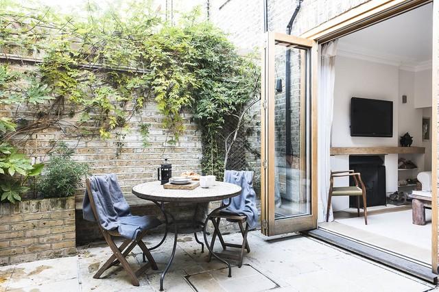 Stylish Scandi Style garden apartment in Chelsea. - Nórdico - Jardín ...