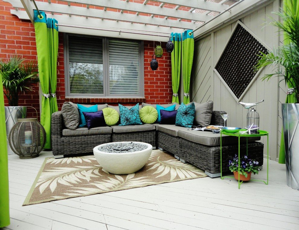 This is an example of a contemporary backyard patio in Toronto with a pergola and decking.