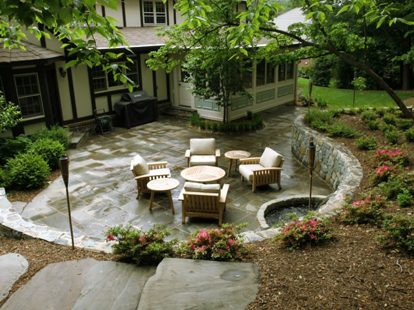 Example Of A Large Trendy Backyard Stone Patio Fountain Design In DC Metro