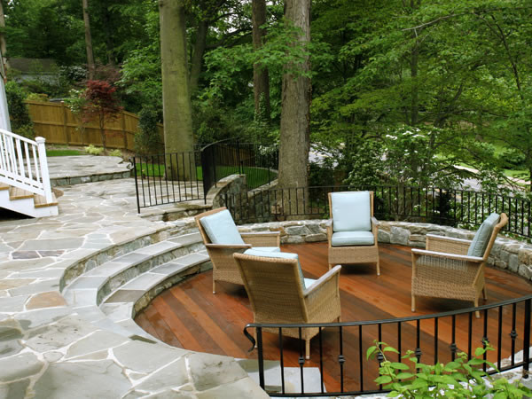 Sunken Wood Patio And Flagstone Patio On Wooded Slope