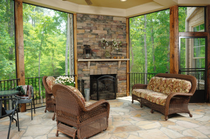 Sunroom Patio With Stone And Fireplace