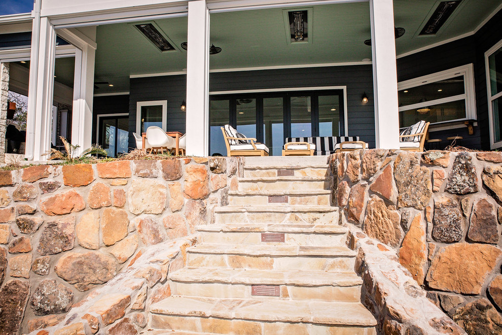 Inspiration for a large coastal backyard concrete patio remodel in Dallas with a fire pit and a roof extension
