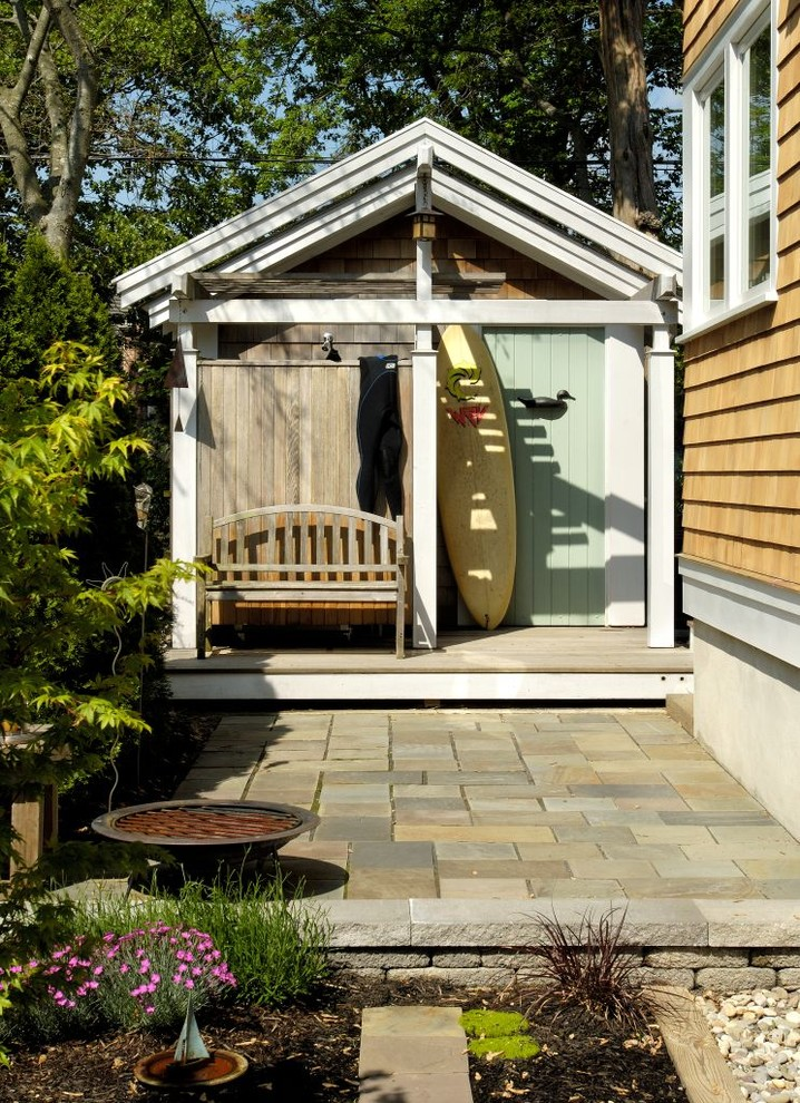 Mid-sized eclectic side yard stone outdoor patio shower photo in New York