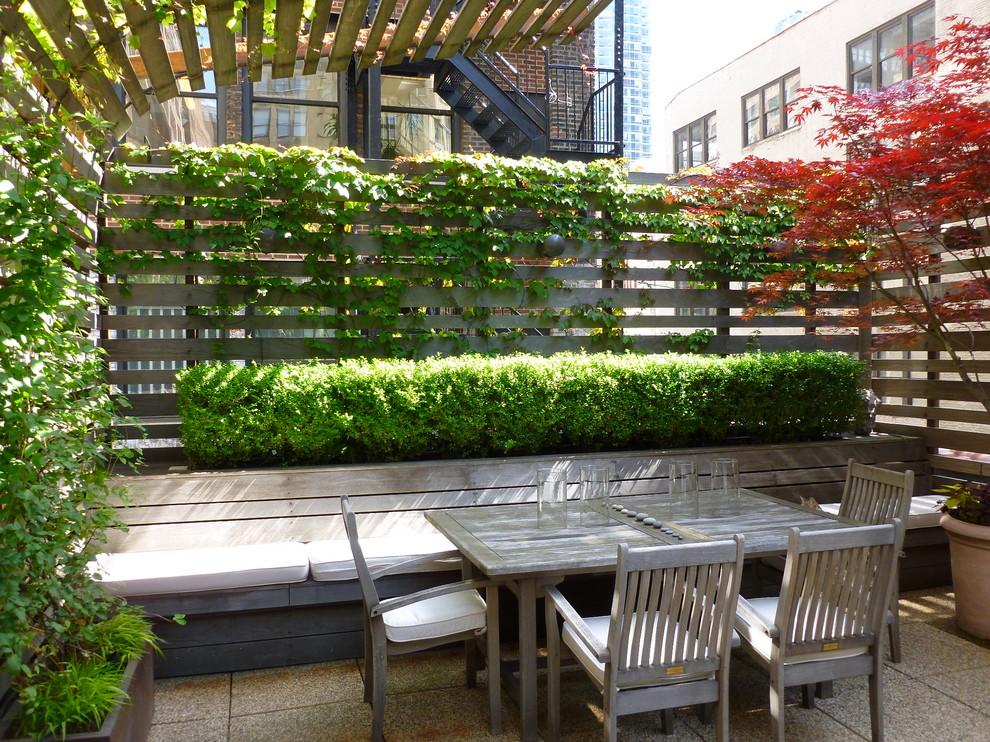 Large trendy patio vertical garden photo in New York