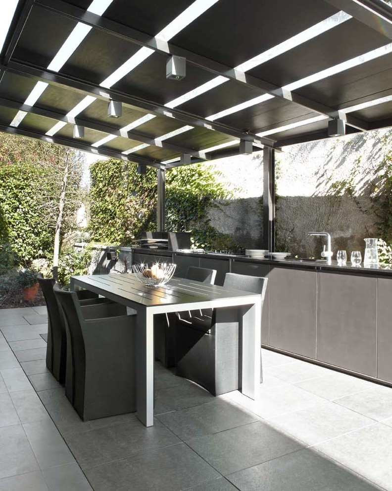 Mid-sized trendy patio kitchen photo in Other with a pergola