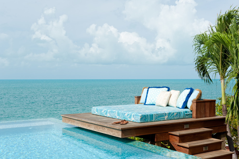 Patio - tropical patio idea in New York with decking