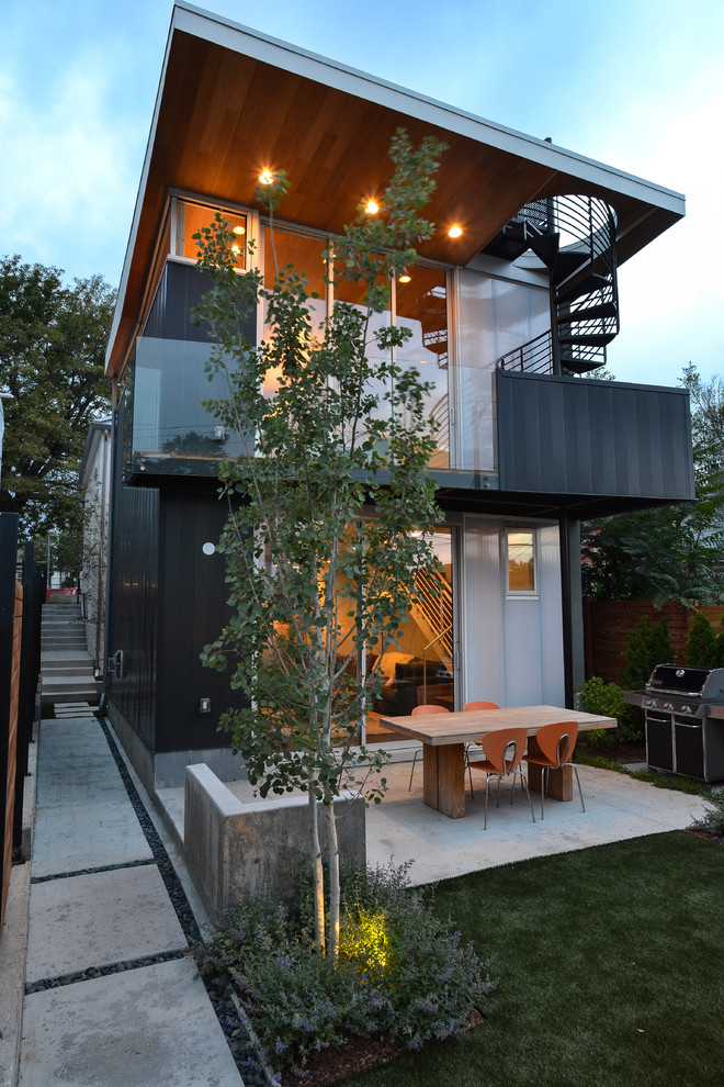 Patio - mid-sized contemporary backyard concrete patio idea in Denver with no cover
