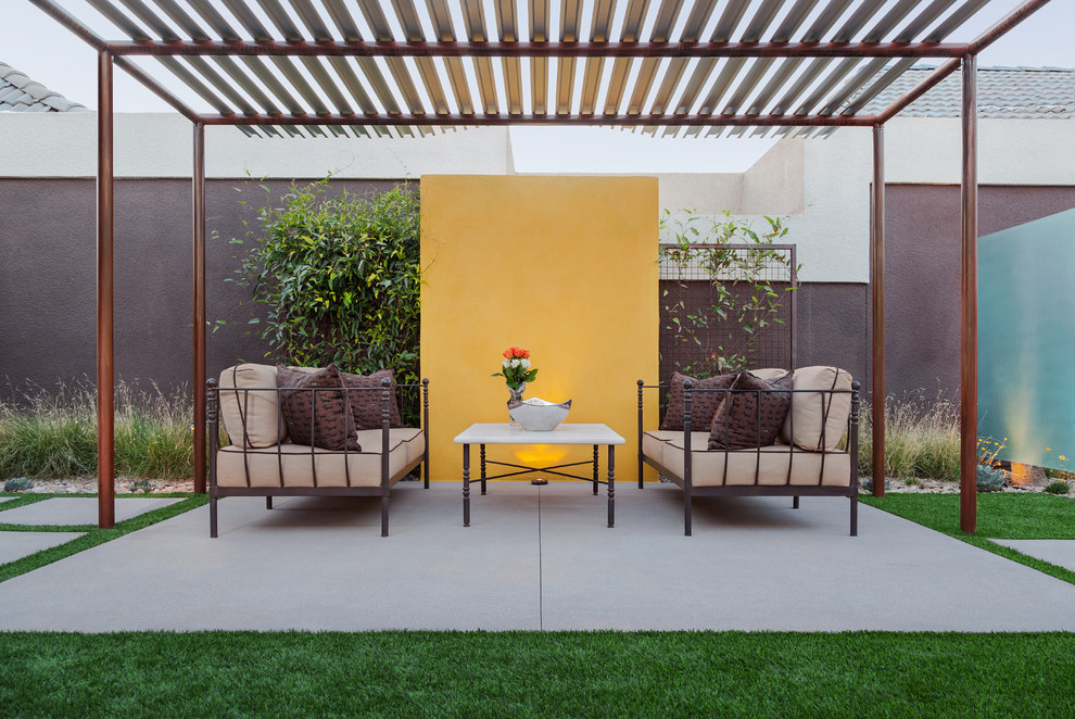 Inspiration for a large modern backyard patio remodel in Phoenix with a gazebo