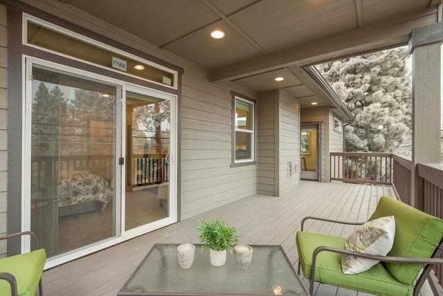 Large arts and crafts backyard patio photo in Other with decking and a roof extension