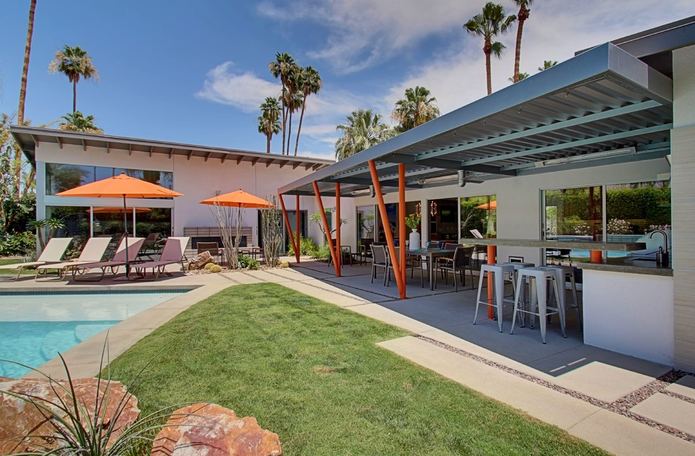 Example of a mid-century modern patio design in Other