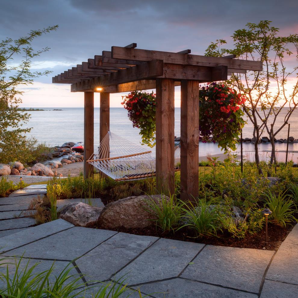 Patio - coastal patio idea in Toronto with a gazebo