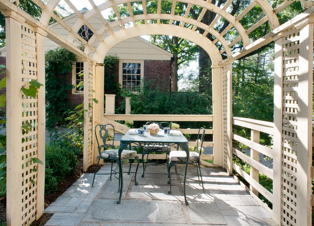 Inspiration for a timeless patio remodel in Boston with a pergola