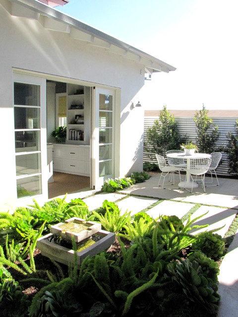 Beach Style Patio by Tara Bussema - Neat Organization and Design