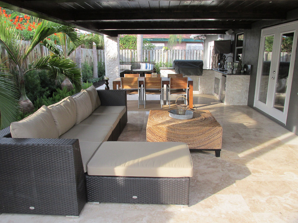 Example of a trendy patio kitchen design in Miami with a roof extension