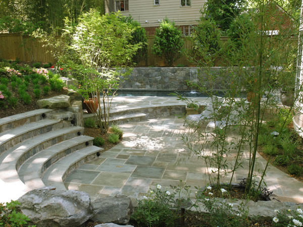 Tiered Backyard With Pool : Tiered Flagstone Patio With Lap Pool contemporarypatio
