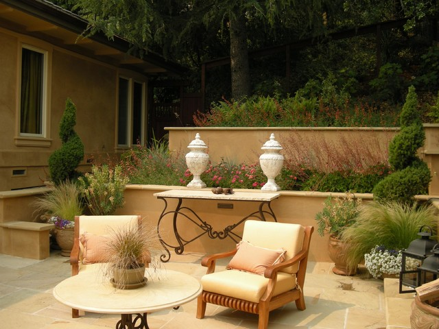 Tiered stucco walls and terrace mediterranean patio for Stucco garden wall designs