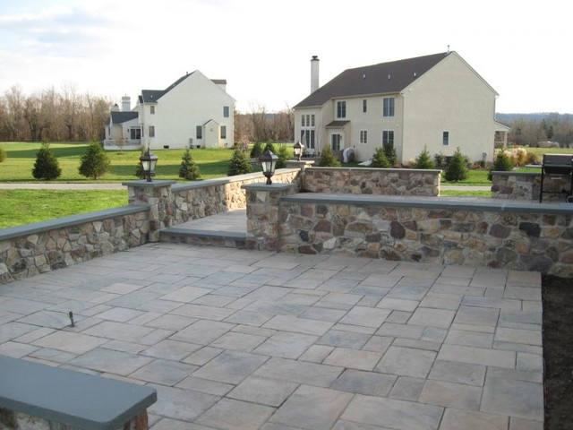 Tiered Techo Bloc Patio With Accent Lighting Traditional Patio