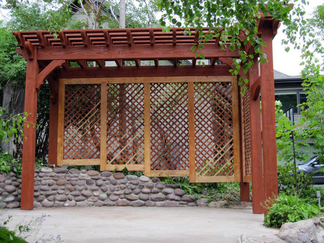 Timber frame arbor with privacy trellis next to backyard for Rustic outdoor privacy screens