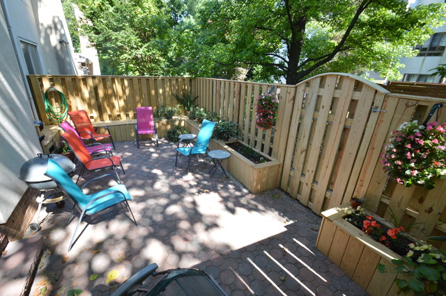 Townhouse patio with fence, benches and planter boxes - Traditional ...