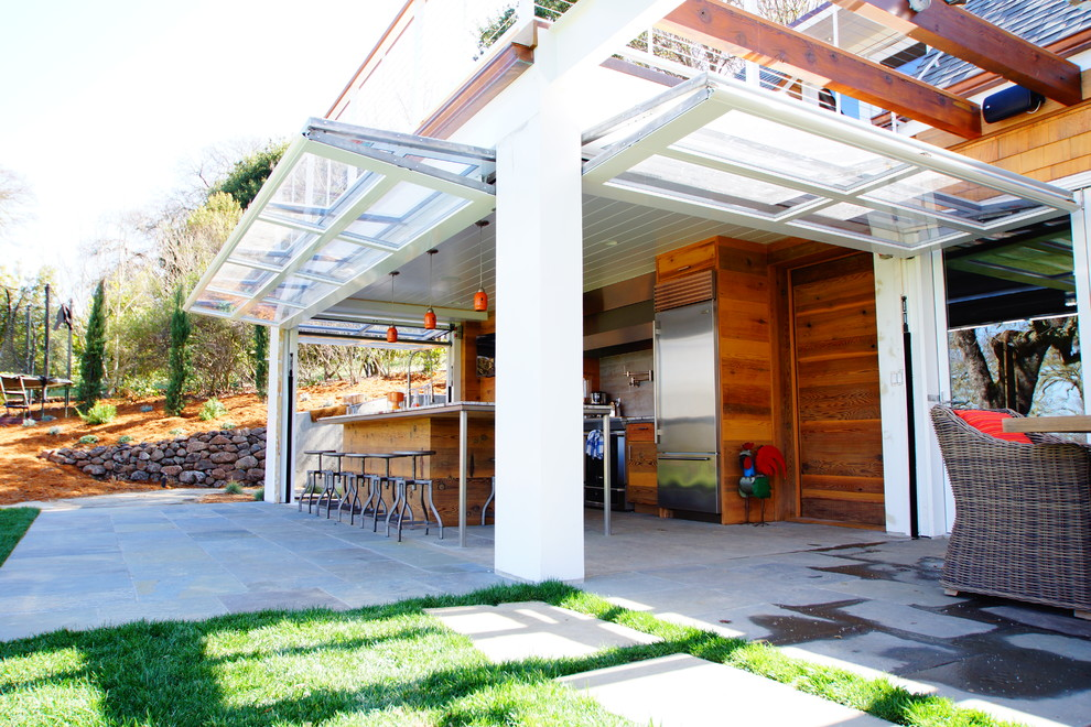 Example of a classic patio kitchen design in San Francisco with a roof extension