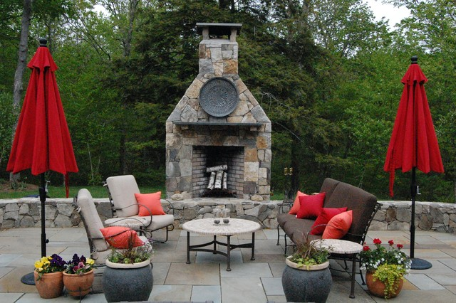 Patio - traditional stone patio idea in New York with a fire pit