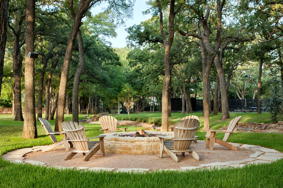 Patio - traditional gravel patio idea in Austin with a fire pit