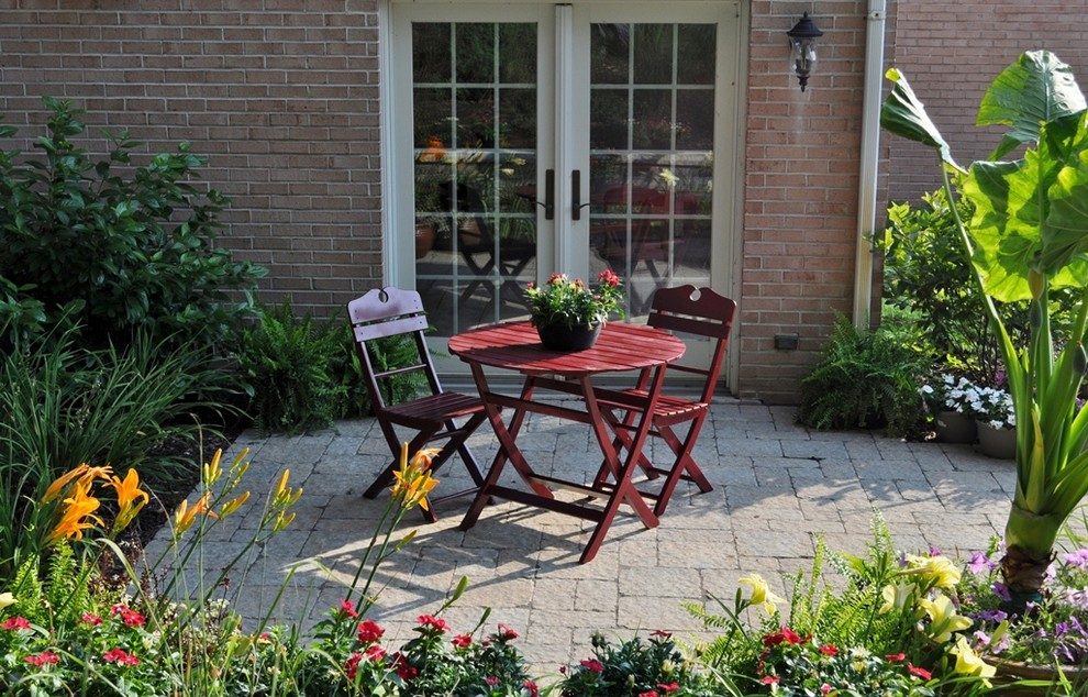 Example of a small classic backyard brick patio design in Chicago with no cover