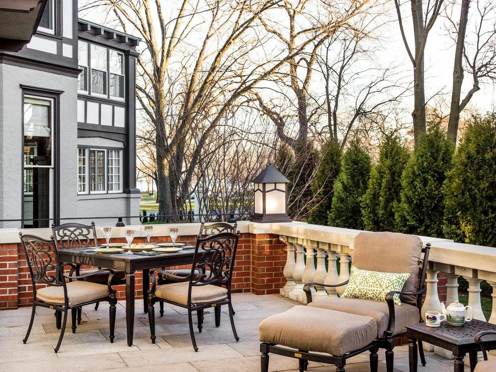 Mid-sized elegant backyard stone patio photo in Chicago with no cover