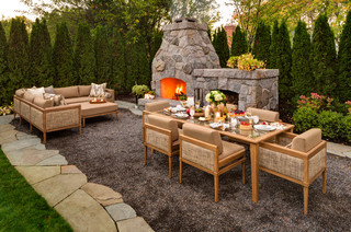 Small outdoor fireplace with seating and dining areas.