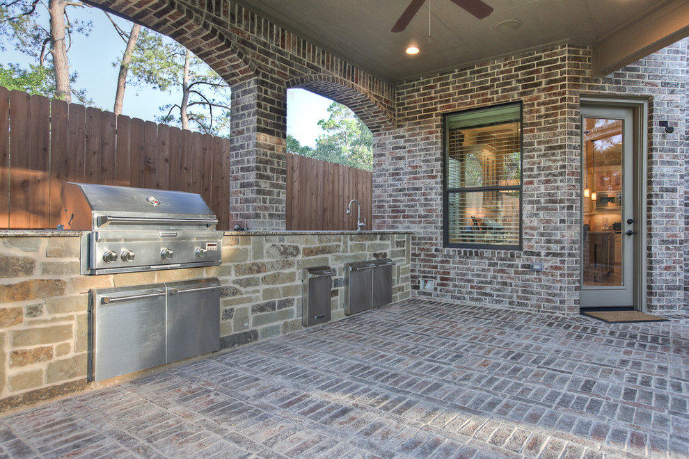 Example of a classic backyard patio kitchen design in Houston