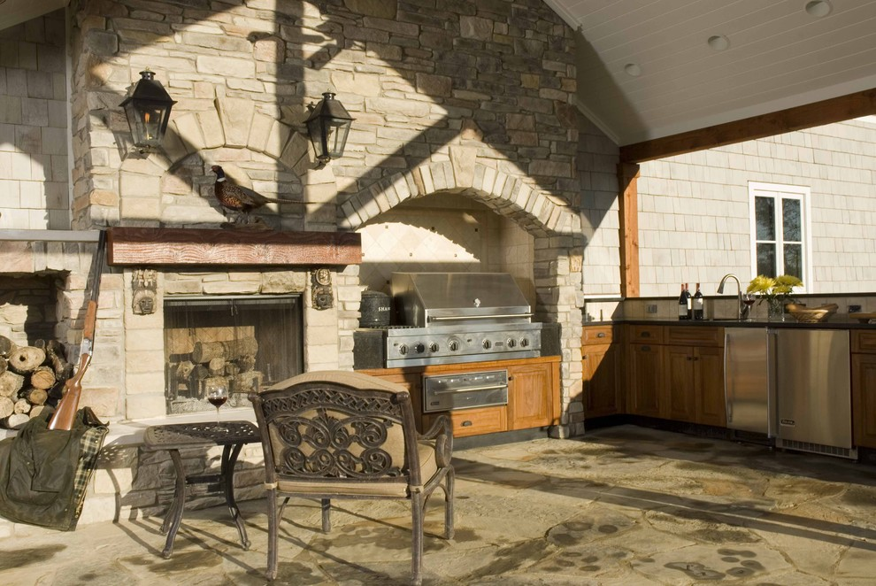 Example of a classic patio design in Other with a fire pit and a pergola