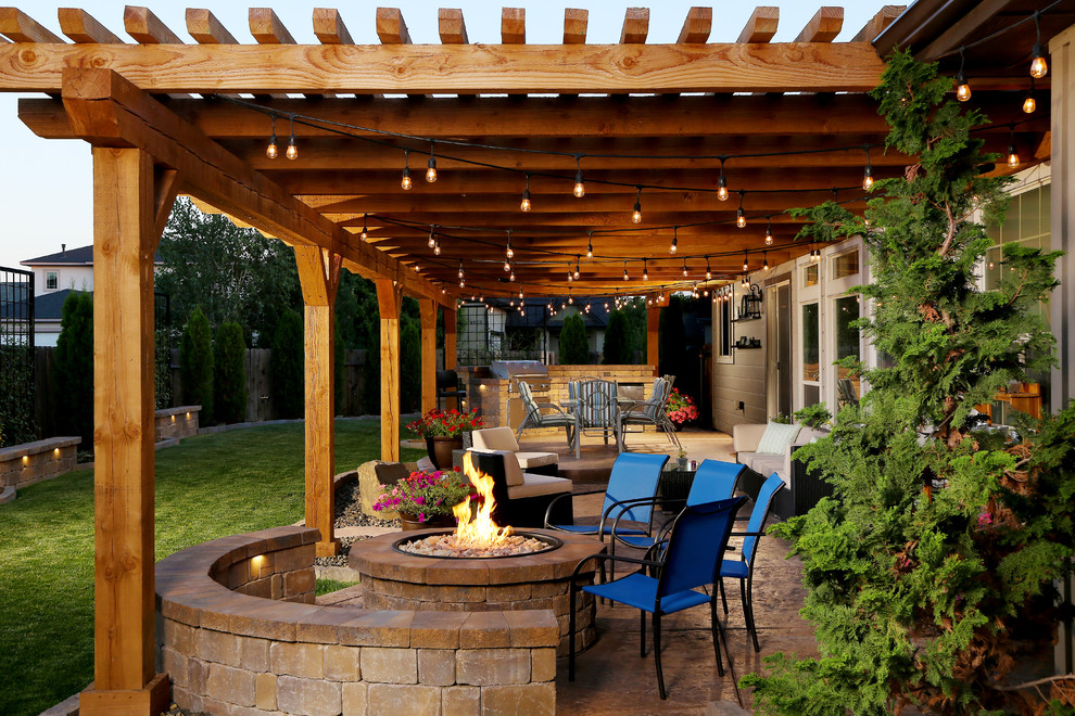 Inspiration for a mid-sized timeless backyard patio remodel in Boise with a fire pit and a pergola