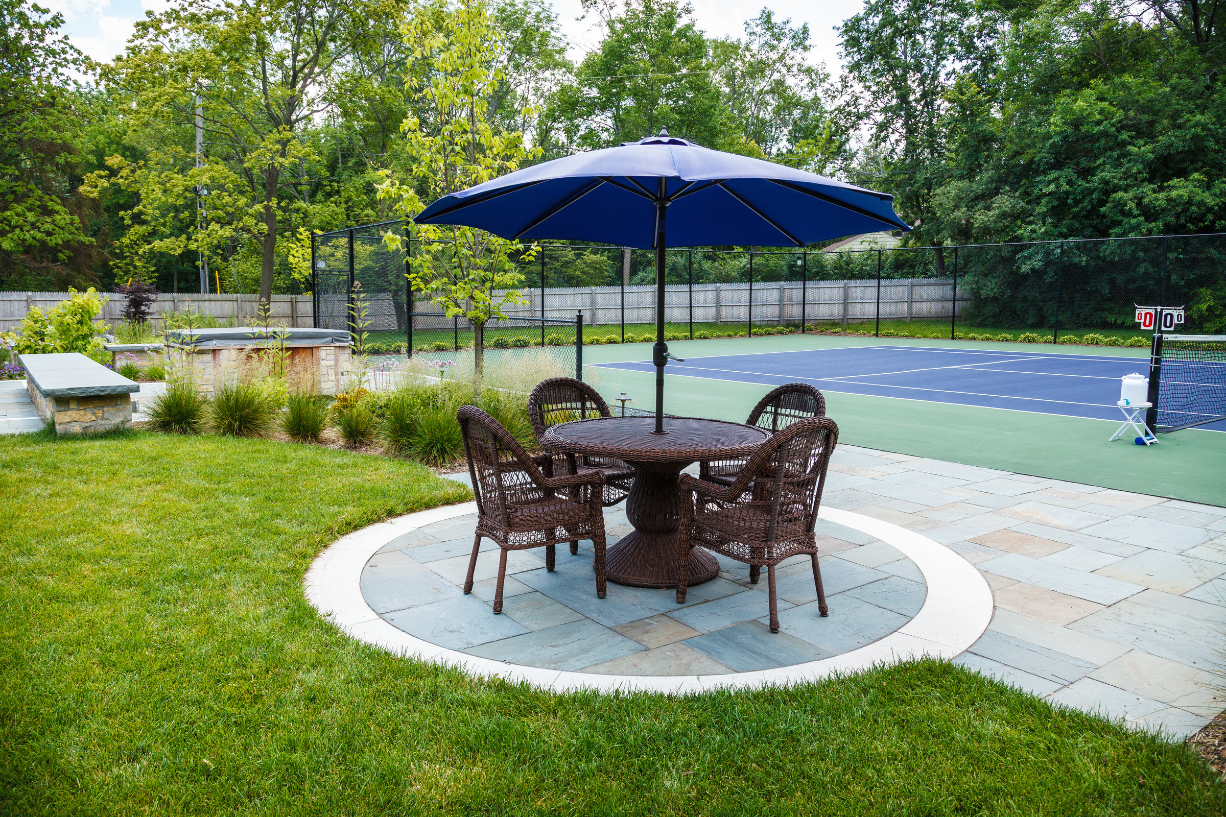 Traditional Tennis Court and Patio - Fox Point