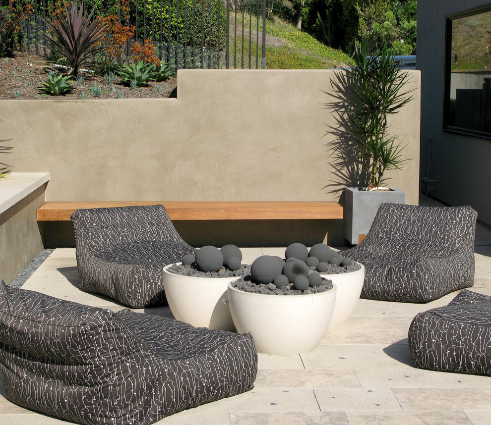 Trendy patio photo in San Diego with a fire pit