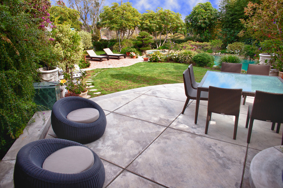 Patio - transitional concrete patio idea in Los Angeles with no cover