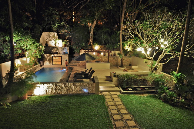 Tropical Garden With Swimming Pool And Patio