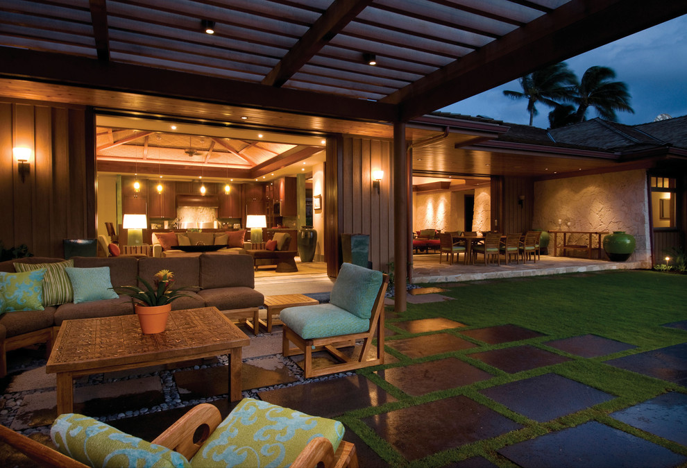 Island style patio photo in Hawaii with a pergola