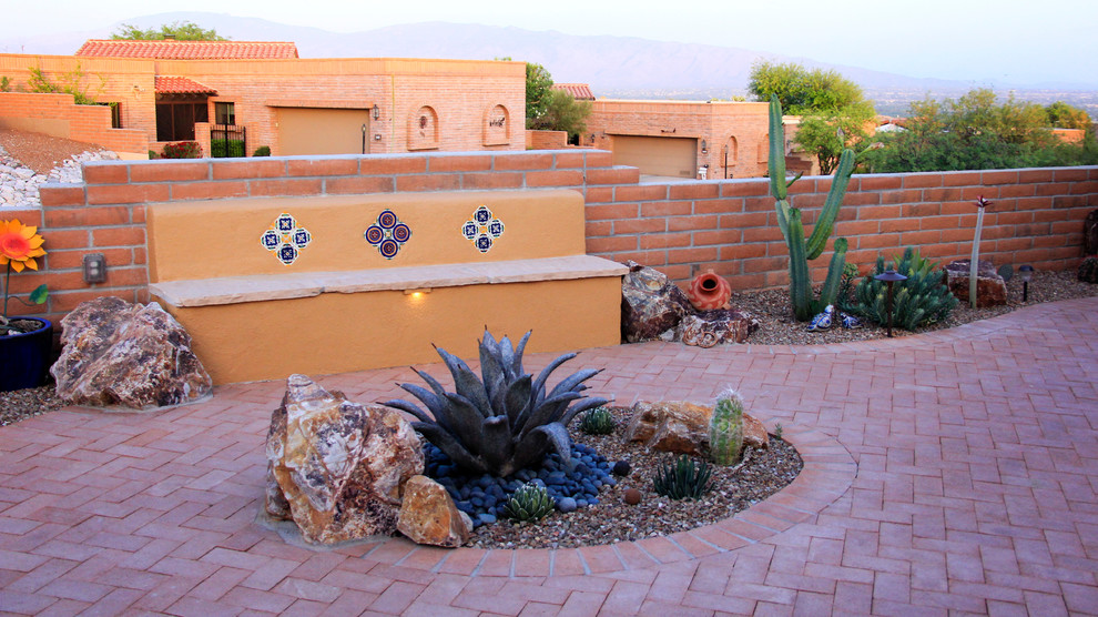 Example of a mid-sized southwest front yard brick patio design in Phoenix with no cover