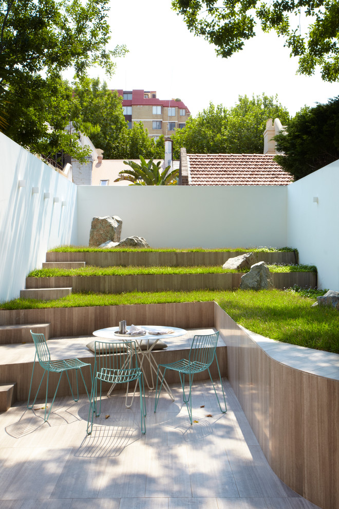 Inspiration for a contemporary patio remodel in Sydney with no cover
