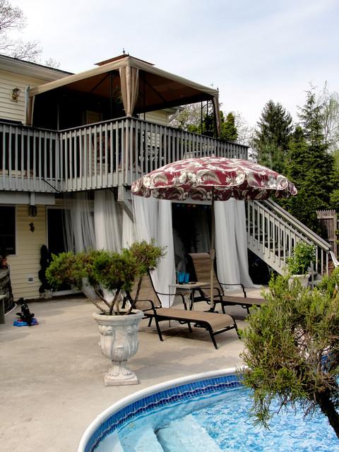 Under deck cabana seating area tropical-patio