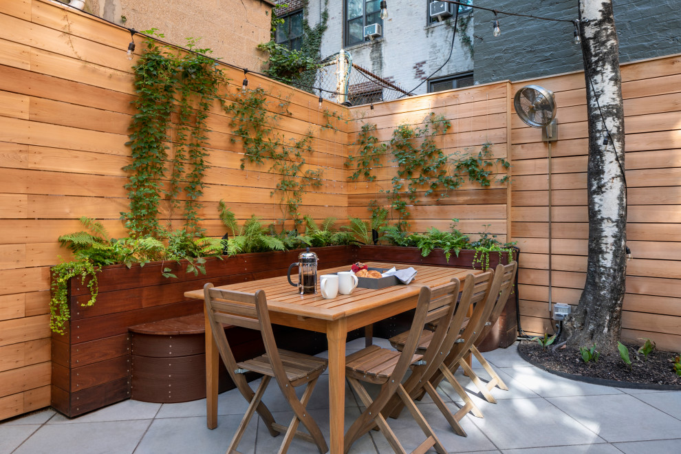 Inspiration for a mid-sized contemporary backyard concrete paver patio vertical garden remodel in New York with no cover