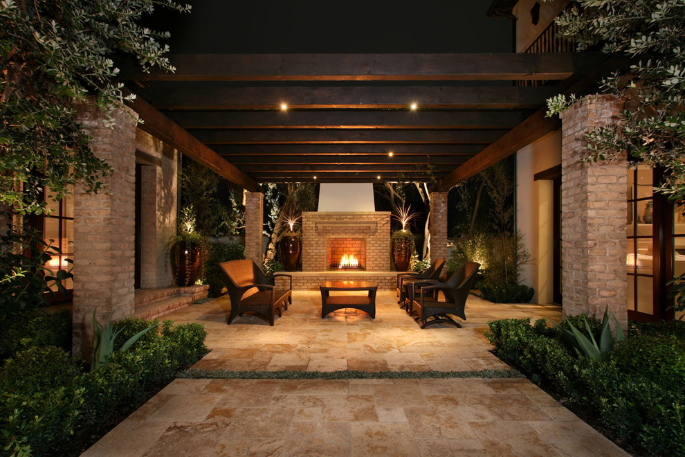 Inspiration for a contemporary courtyard patio remodel in Los Angeles with a fire pit and a pergola