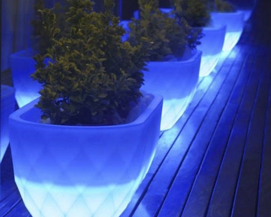 Vases Illuminated Outdoor Planter - This illuminated outdoor planter is available with LED lighting in multiple colors or a style with a fluorescent bulb that displays only white light.